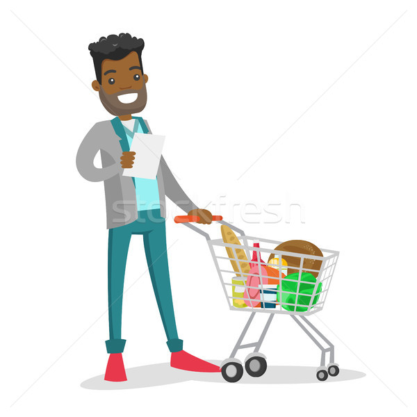 Young african-american man checking shopping list. Stock photo © RAStudio