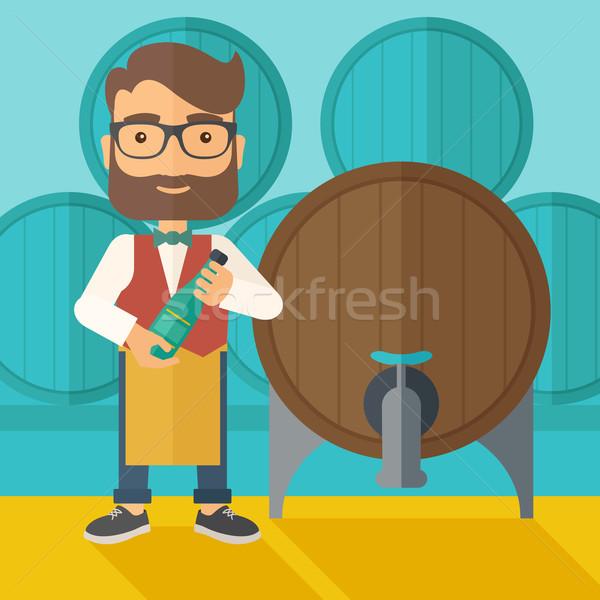 Wine maker inspecting wine from barrel. Stock photo © RAStudio