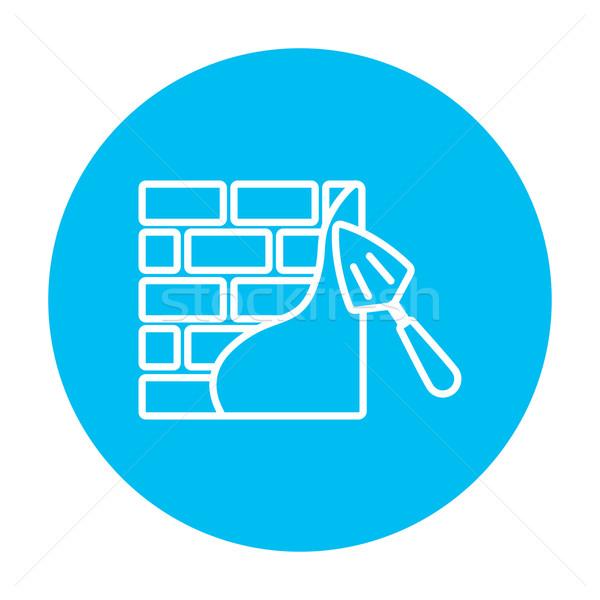 Spatula with brickwall line icon. Stock photo © RAStudio