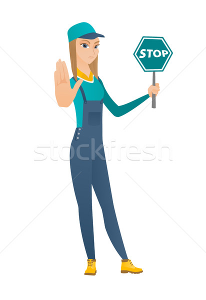 Caucasian mechanic holding stop road sign. Stock photo © RAStudio