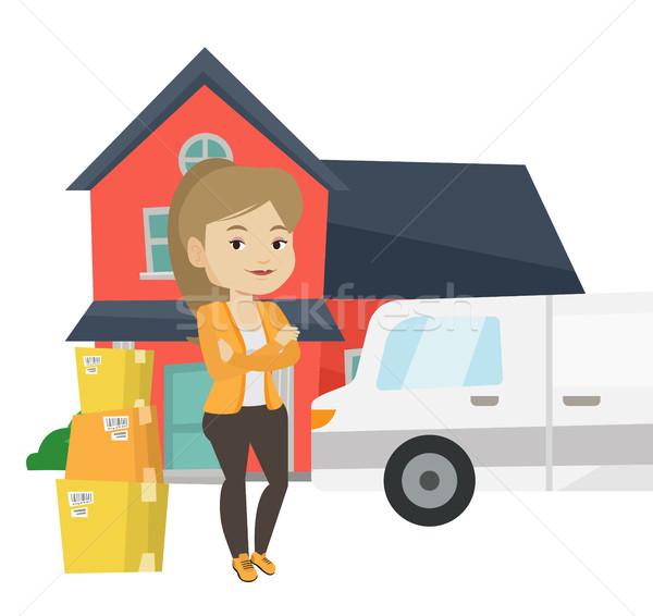 Nő mozog ház fiatal háztulajdonos áll Stock fotó © RAStudio