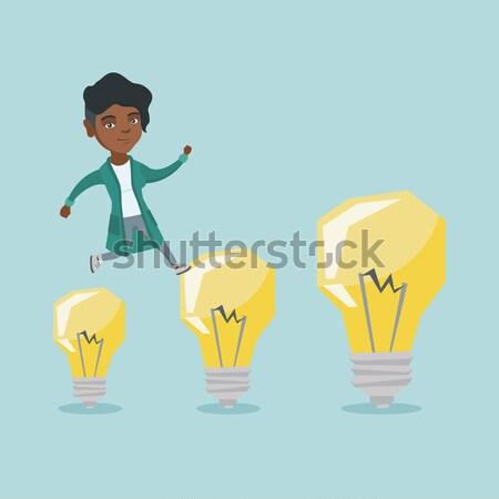 Business man jumping on light bulbs. Stock photo © RAStudio