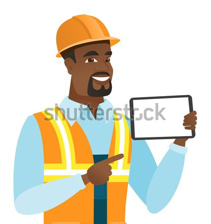 African-american builder using laptop. Stock photo © RAStudio