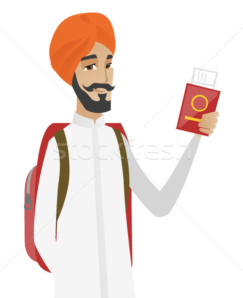 Hindu man traveler holding passport with ticket. Stock photo © RAStudio