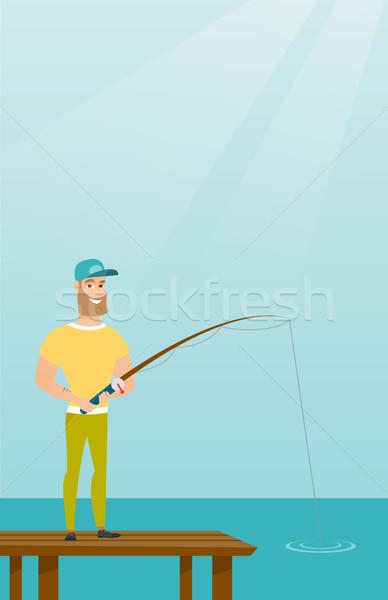 Young caucasian man fishing on jetty. Stock photo © RAStudio