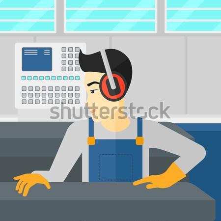 Man working on metal press machine. Stock photo © RAStudio