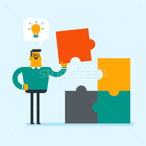 Businessman got idea of the completing of puzzle. Stock photo © RAStudio