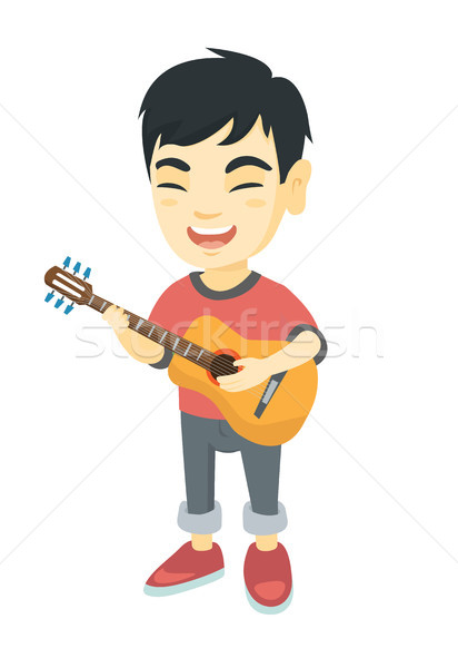 Asian garçon chanter jouer guitare acoustique Photo stock © RAStudio