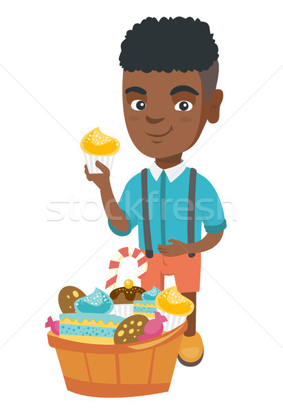 Boy holding a cupcake and stroking his belly. Stock photo © RAStudio