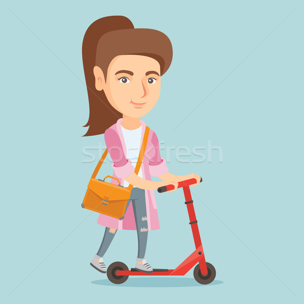 Young caucasian business woman riding kick scooter Stock photo © RAStudio