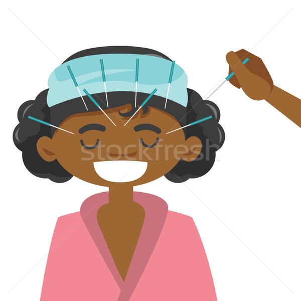 African-american woman getting acupuncture therapy Stock photo © RAStudio