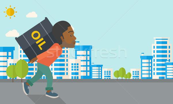 Fekete üzletember hordoz hordó olaj sétál Stock fotó © RAStudio