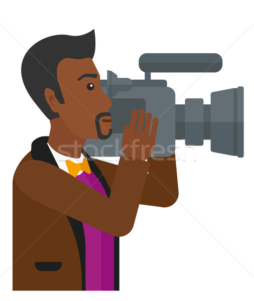 Stock photo: Cameraman with video camera.