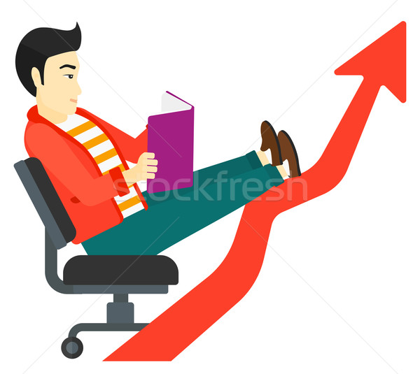 Businessman reading book. Stock photo © RAStudio