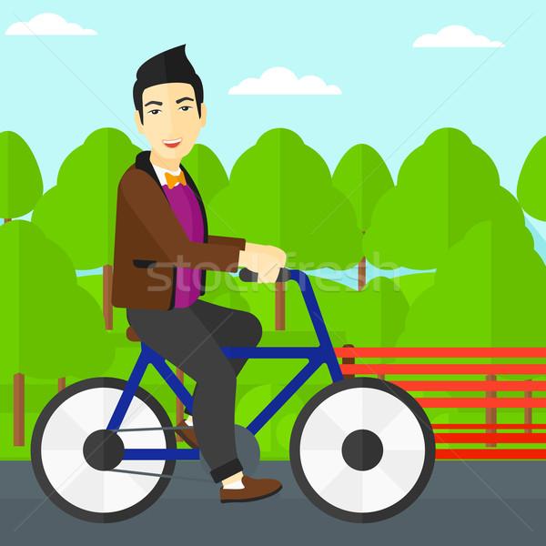 Férfi lovaglás bicikli ázsiai park vektor Stock fotó © RAStudio