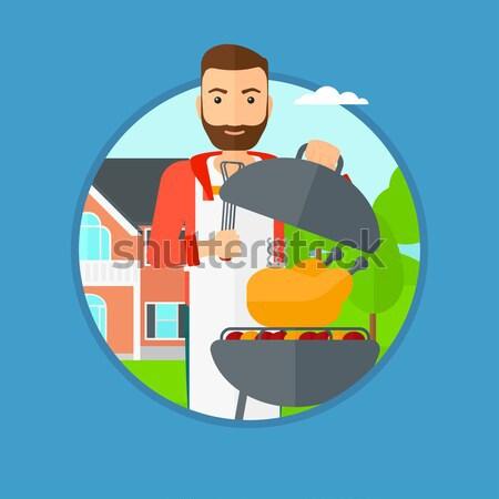 Férfi főzés tyúk barbecue grill udvar barbecue Stock fotó © RAStudio