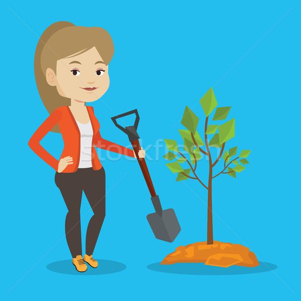 Woman plants tree vector illustration. Stock photo © RAStudio