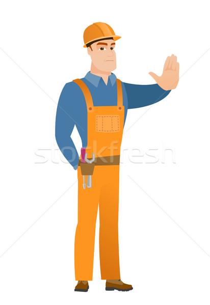 Caucasian builder showing stop hand gesture. Stock photo © RAStudio