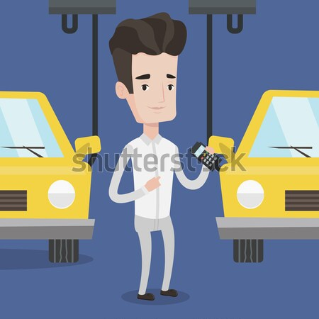 Worker controlling automated assembly line for car Stock photo © RAStudio