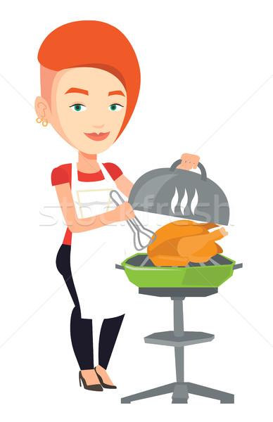 Nő főzés tyúk barbecue grill kaukázusi kint Stock fotó © RAStudio