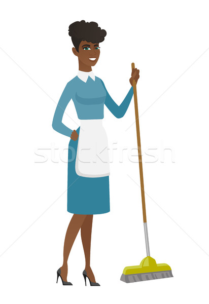 Young housemaid sweeping floor with a broom. Stock photo © RAStudio