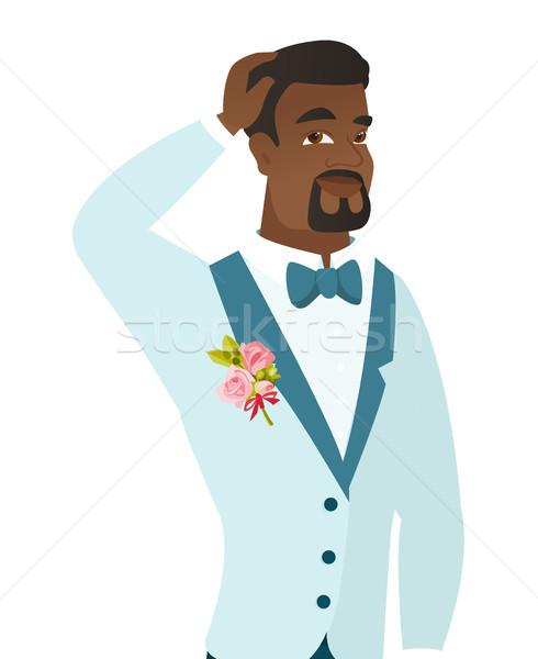 Young african-american groom scratching his head. Stock photo © RAStudio