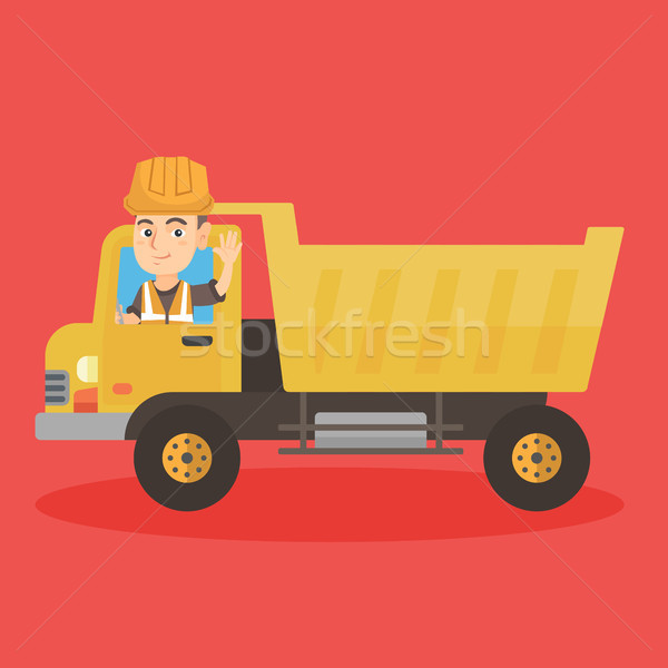 Little caucasian driver driving a dump truck. Stock photo © RAStudio