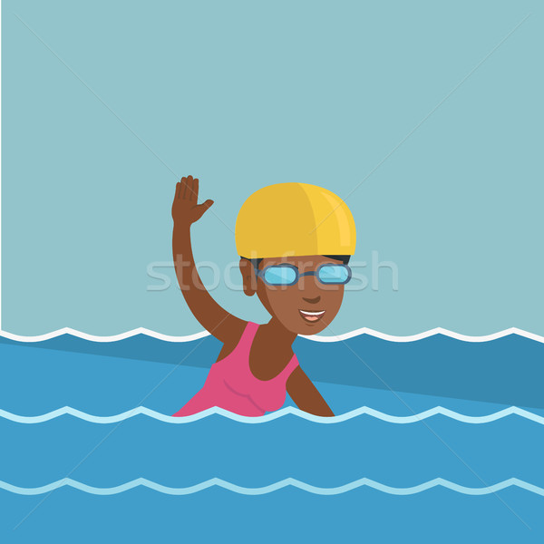Young african-american sportswoman swimming. Stock photo © RAStudio