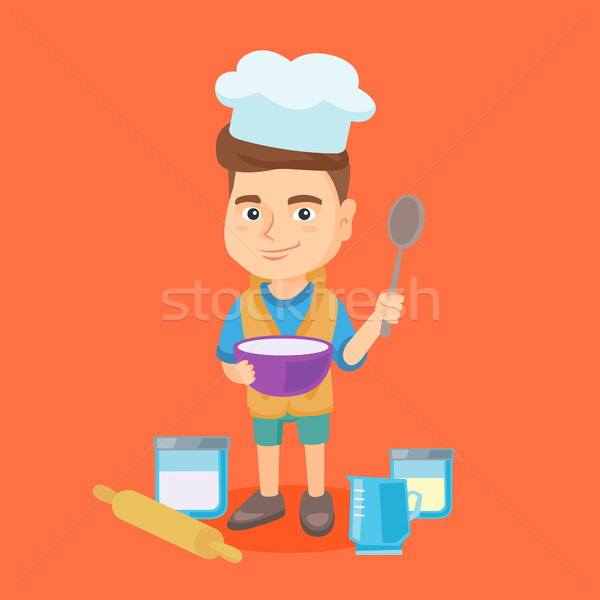 Caucasian boy holding a saucepan and a spoon. Stock photo © RAStudio