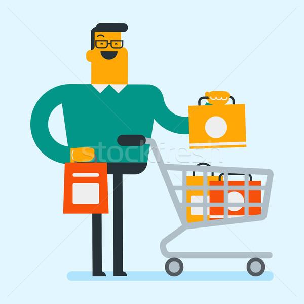 Young caucasian white man with shopping bags. Stock photo © RAStudio