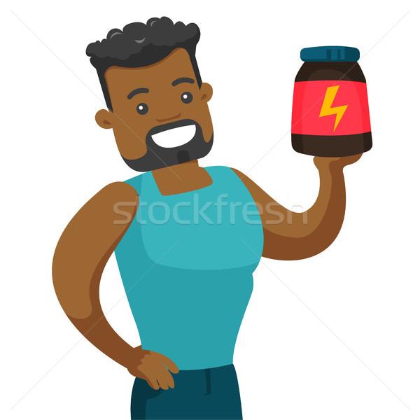 Jóvenes hombre proteína jar Foto stock © RAStudio
