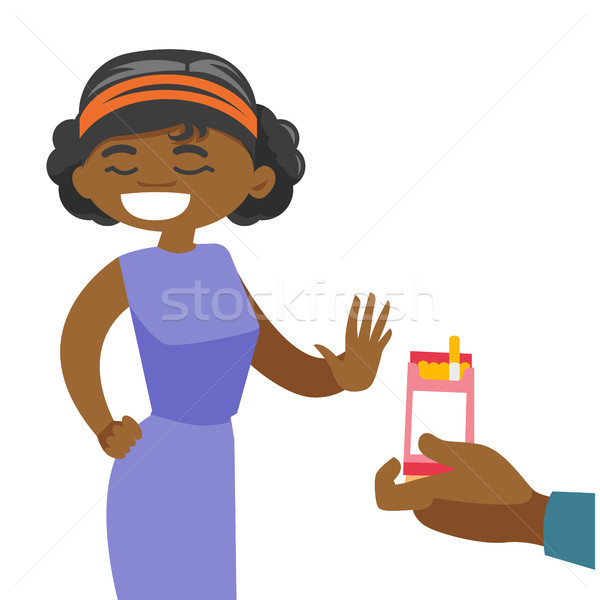 Young african woman refusing to take a cigarette. Stock photo © RAStudio