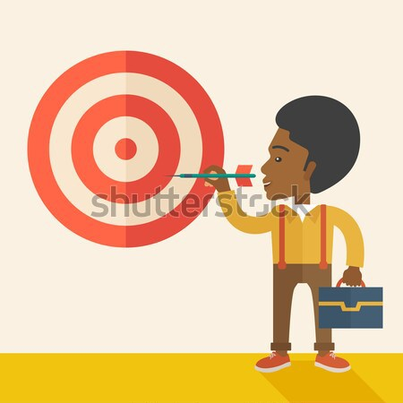 Working chinese man holding a target arrow  Stock photo © RAStudio