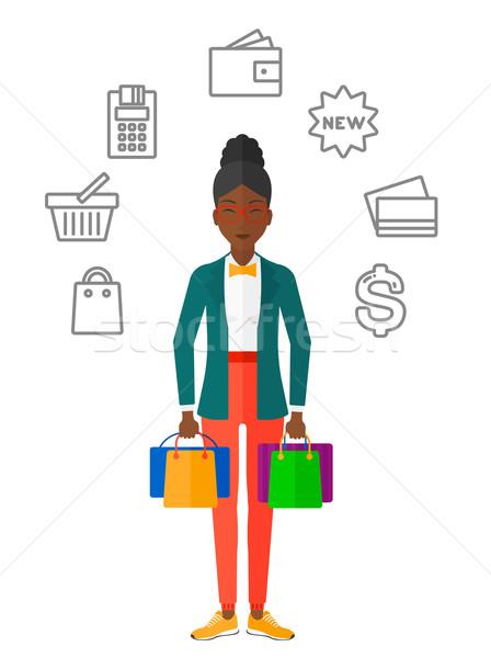 Happy customer with bags. Stock photo © RAStudio