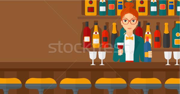 Barkeeper stehen bar counter halten Flasche Stock foto © RAStudio