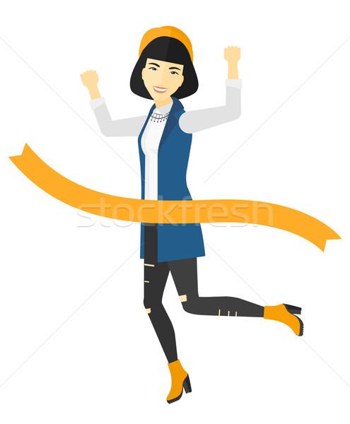 Business woman crossing finish line. Stock photo © RAStudio