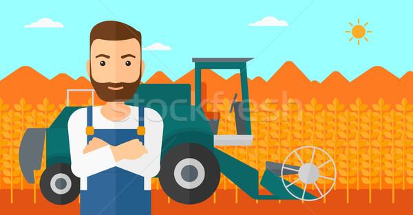 Man standing with combine on background. Stock photo © RAStudio