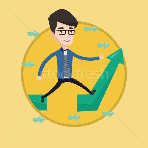 Businessman jumping over gap on arrow going up. Stock photo © RAStudio