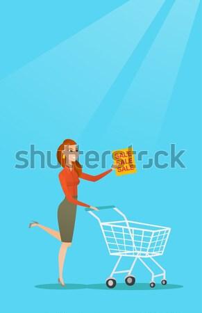 Compra casa feliz mujer empujando Foto stock © RAStudio