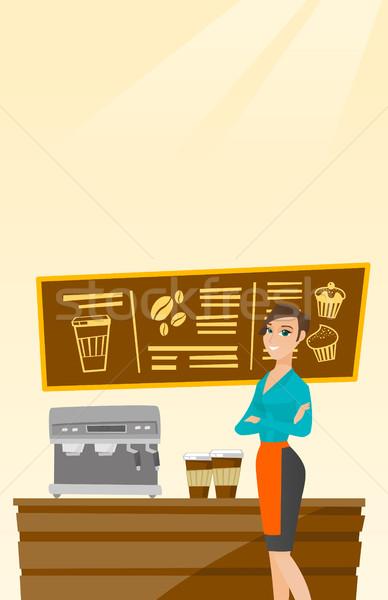 Stock photo: Barista standing near coffee machine.