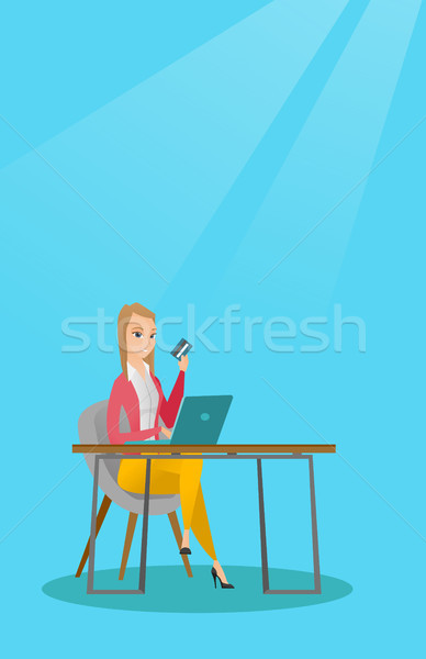 Young caucasian woman paying online by credit card Stock photo © RAStudio