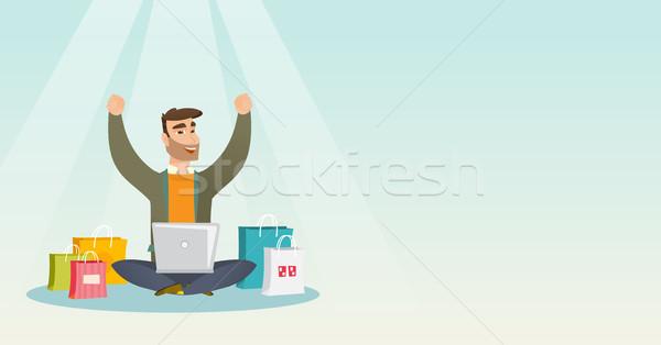 Caucasiano homem usando laptop compras on-line jovem Foto stock © RAStudio