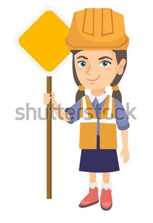 Little caucasian builder boy holding road sign. Stock photo © RAStudio