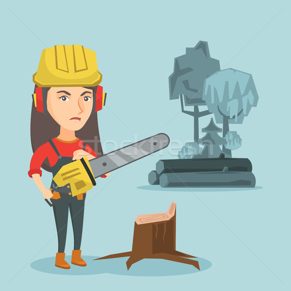 Young caucasian lumberjack holding a chainsaw. Stock photo © RAStudio