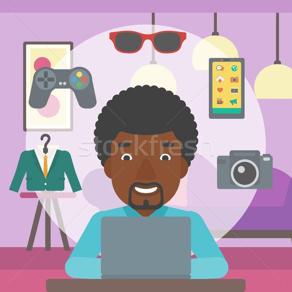 Man shopping online using his laptop. Stock photo © RAStudio