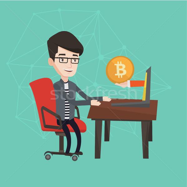 Man getting bitcoin coin from bitcoin trading. Stock photo © RAStudio