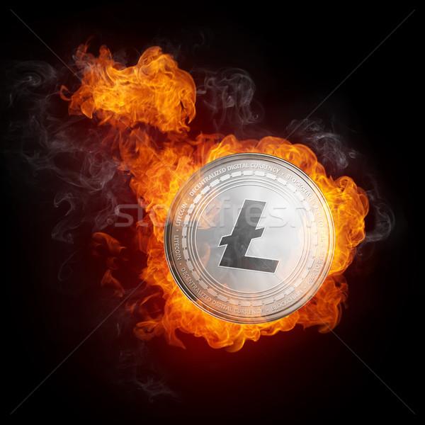 Golden Litecoin coin falling in fire flame. Stock photo © RAStudio