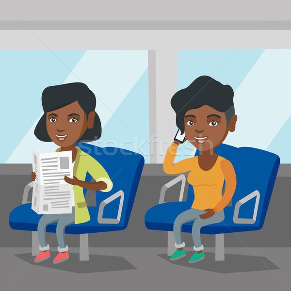Afrikaanse vrouwen openbaar vervoer vrouw mobiele telefoon Stockfoto © RAStudio