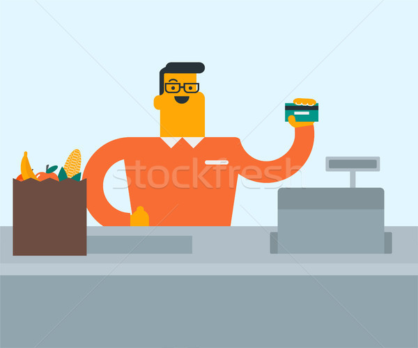 Young caucasian white cashier holding credit card. Stock photo © RAStudio