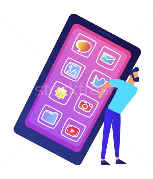 Businessman holding a big mobile phone vector illustration. Stock photo © RAStudio